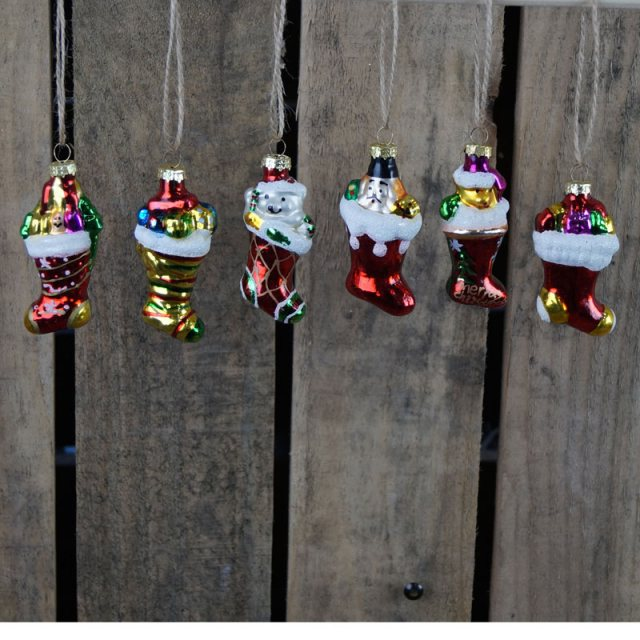 Box of six hanging glass Christmas stocking ornaments.